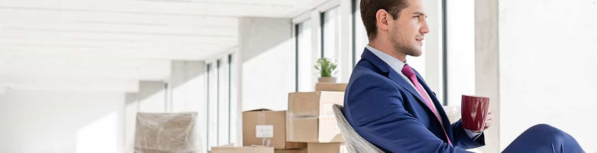 Relaxed man before relocating office